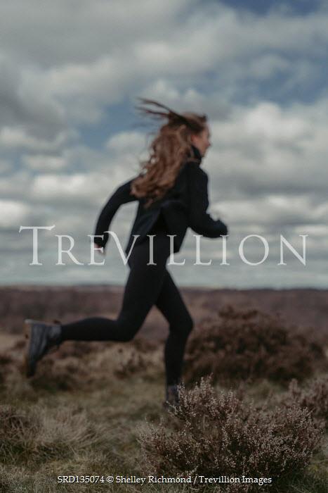 Shelley Richmond GIRL RUNNING IN FLAT COUNTRYSIDE