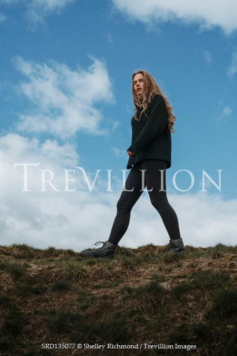 Shelley Richmond GIRL IN SWEATER WALKING IN COUNTRYSIDE