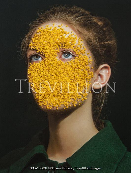 Tijana Moraca WOMAN WITH YELLOW PETALS ON FACE