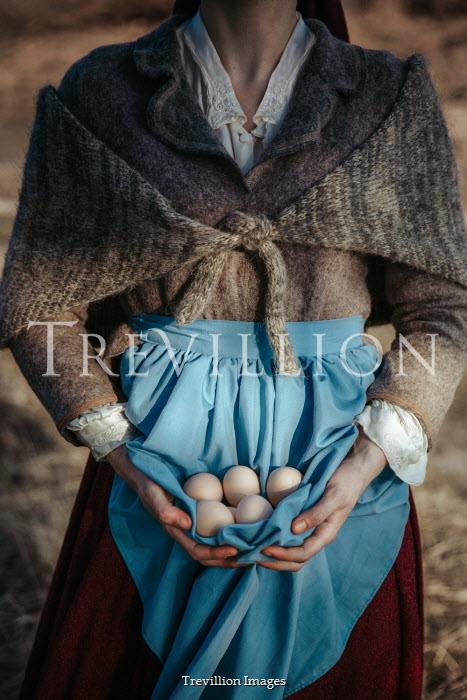 Natasza Fiedotjew historic maid collecting eggs in apron