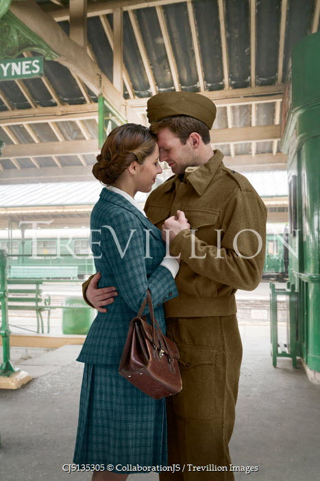 CollaborationJS WARTIME COUPLE EMBRACING IN TRAIN STATION
