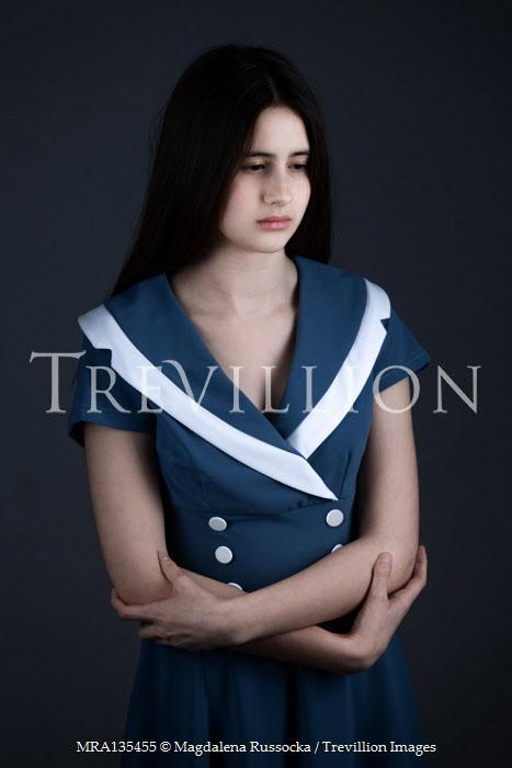 Magdalena Russocka teenage girl wearing blue dress inside