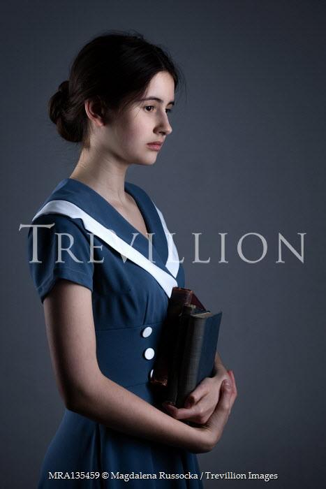 Magdalena Russocka teenage girl holding books inside