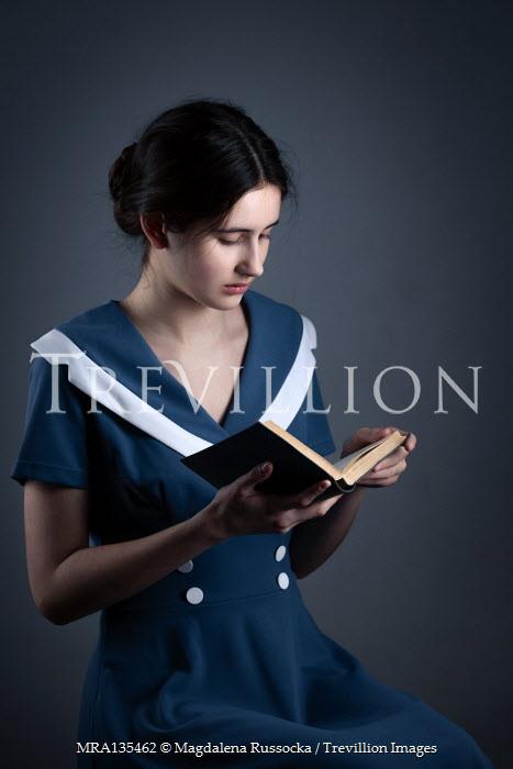 Magdalena Russocka teenage girl reading book inside