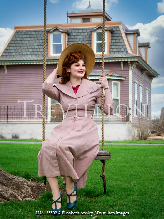 Elisabeth Ansley RETRO WOMAN IN HAT ON SWING BY HOUSE