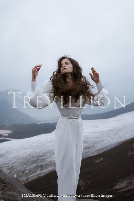 Tatiana Mertsalova BRUNETTE WOMAN IN WHITE IN SNOWY LANDSCAPE