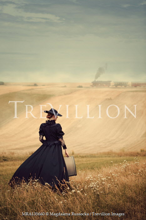 Magdalena Russocka VICTORIAN WOMAN AND CASE WITH LOCOMOTIVE IN COUNTRYSIDE