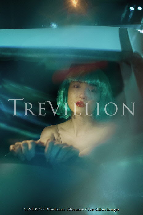 Svitozar Bilorusov WOMAN WITH SILVER HAIR DRIVING CAR AT NIGHT