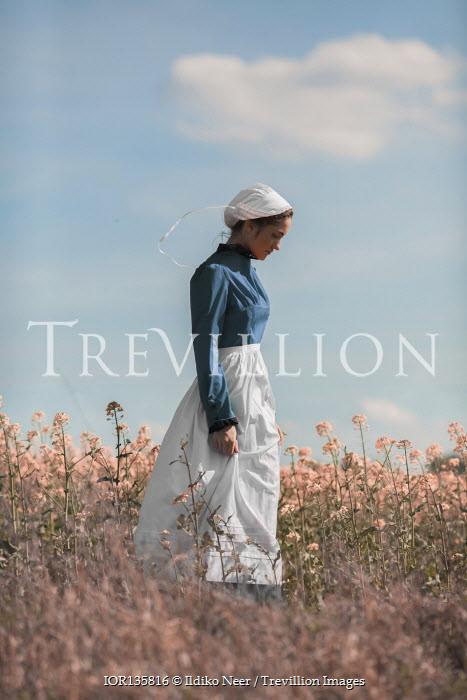 Ildiko Neer Amish woman in meadow