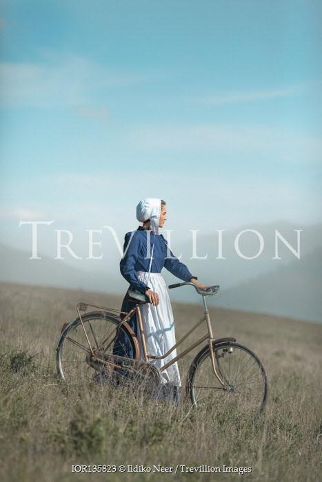 Ildiko Neer Amish woman with bicycle countryside