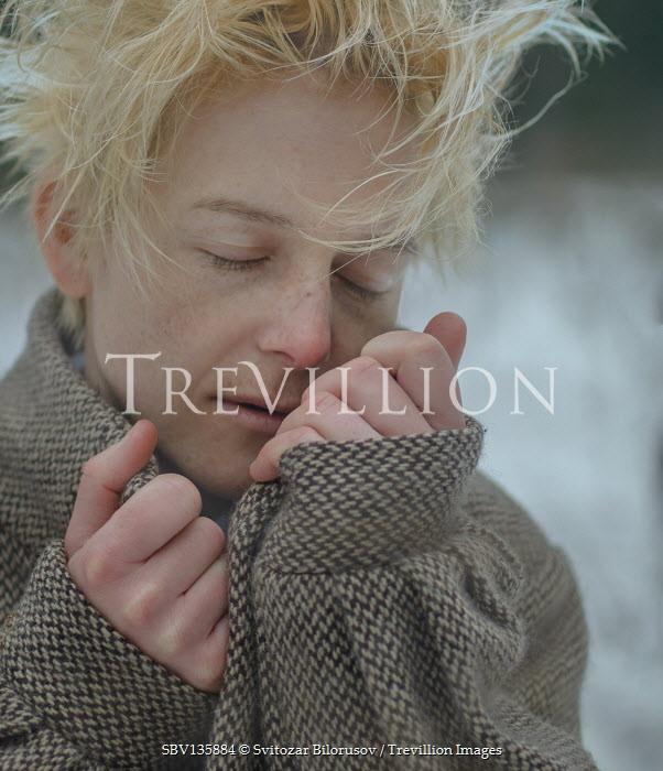 Svitozar Bilorusov BLONDE DAYDREAMING GIRL IN SNOWY FIELD