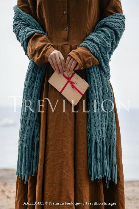Natasza Fiedotjew historic woman holding letter on beach