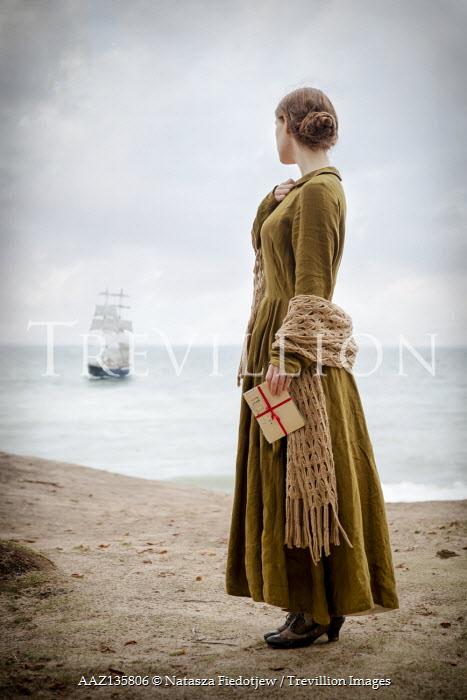 Natasza Fiedotjew woman on beach holding letters watching ship