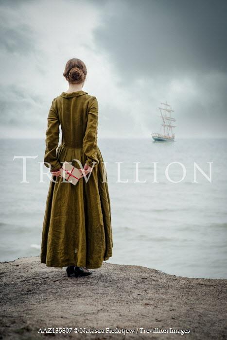 Natasza Fiedotjew historic woman watching sailing ship on shallow