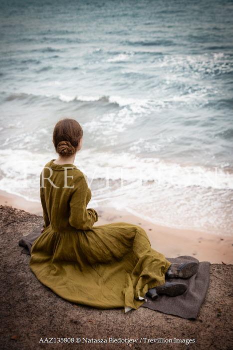 Natasza Fiedotjew vintage woman sitting on cliff above seashore