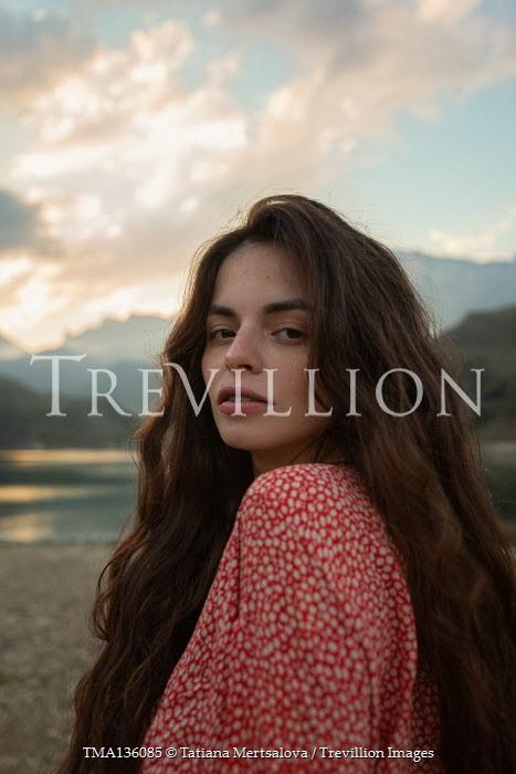 Tatiana Mertsalova WOMAN WITH LONG BROWN HAIR BY LAKE AT DUSK