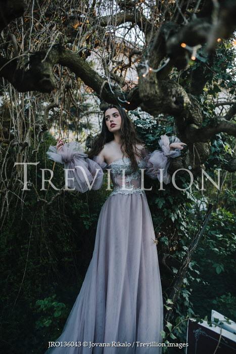 Jovana Rikalo BRUNETTE WOMAN IN SILK GOWN BY TREE