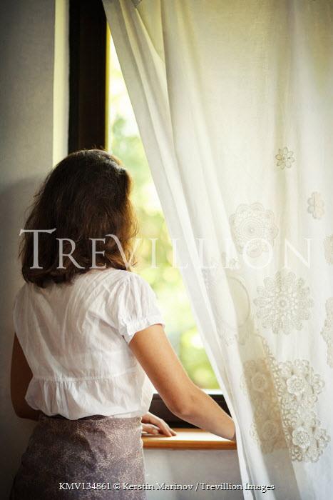 Kerstin Marinov BRUNETTE WOMAN INDOORS WATCHING AT WINDOW