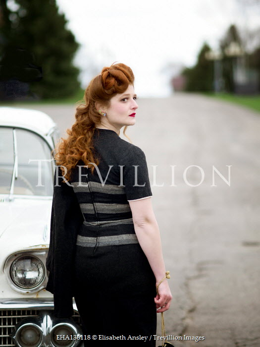 Elisabeth Ansley RETRO WOMAN WITH RED HAIR STANDING BY CAR