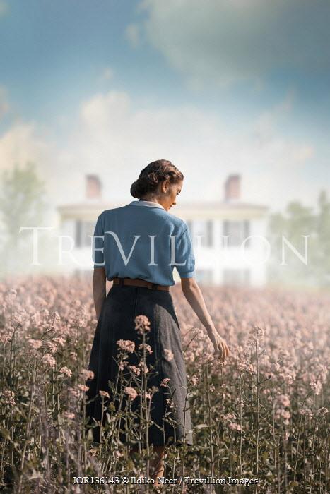 Ildiko Neer Vintage woman standing in meadow by house