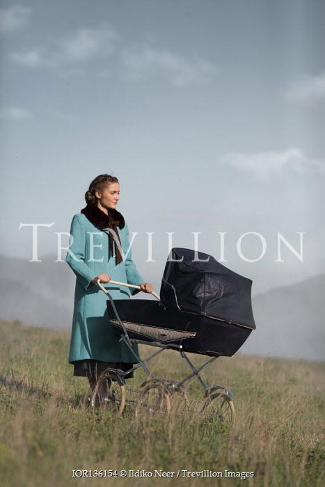 Ildiko Neer Vintage woman with pram by hills