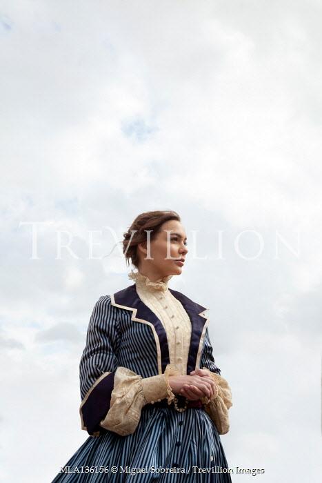 Miguel Sobreira HISTORICAL BRUNETTE WOMAN STANDING OUTDOORS
