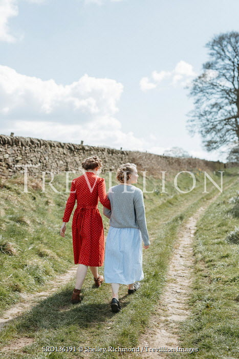 Shelley Richmond TWO RETRO WOMEN ARM ON ARM IN COUNTRY LANE