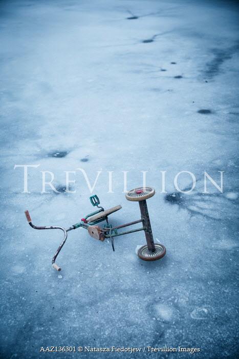 Natasza Fiedotjew child's tricycle lying on ice