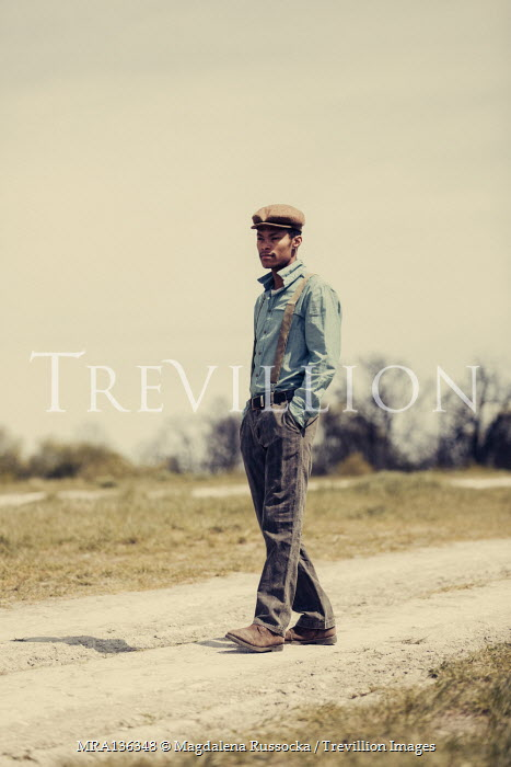 Magdalena Russocka young vintage man walking in countryside