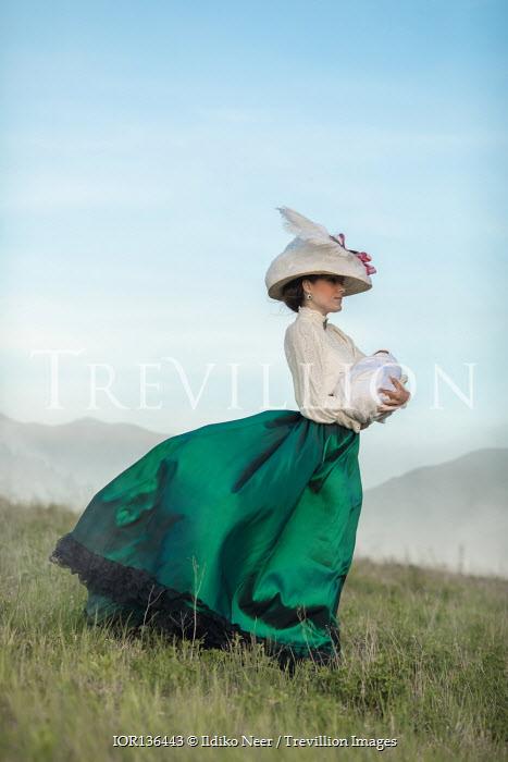 Ildiko Neer Historical woman holding baby in field