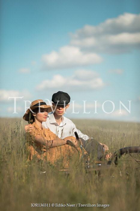 Ildiko Neer Vintage couple sitting in grass
