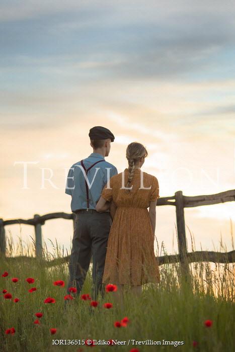 Ildiko Neer Vintage couple standing by fence