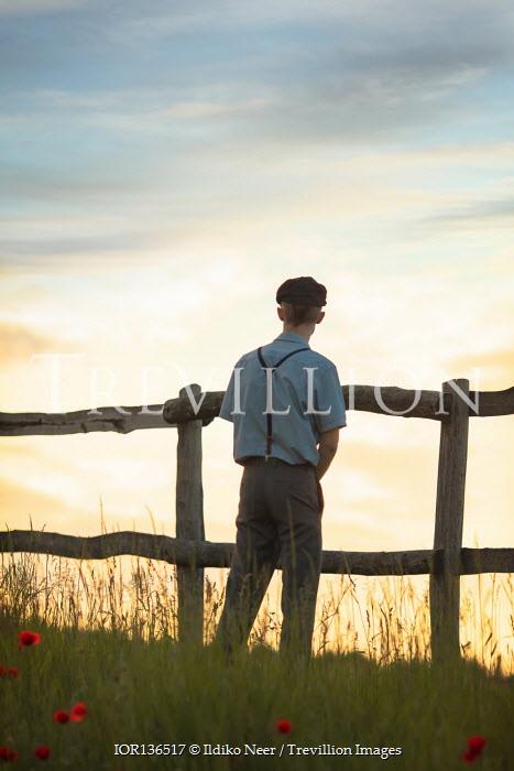 Ildiko Neer Vintage man standing by fence
