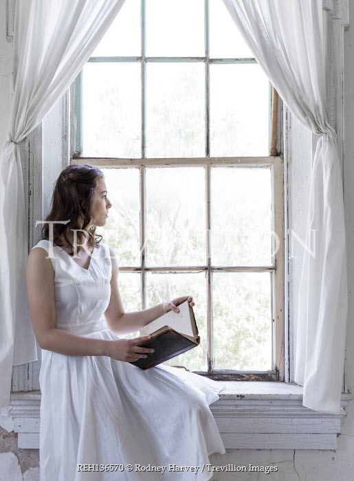 Rodney Harvey WOMAN IN WHITE SITTING BY WINDOW WITH BOOK