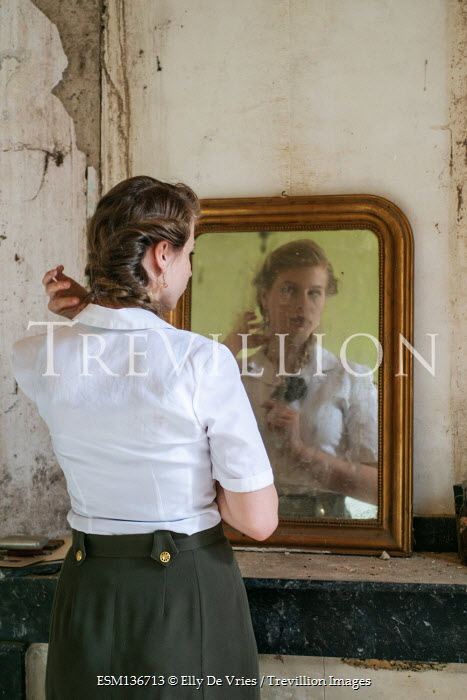 Elly De Vries WOMAN REFLECTED IN MIRROR INSIDE SHABBY BUILDING