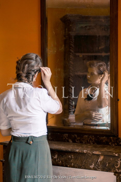 Elly De Vries SERIOUS 1940S WOMAN REFLECTED IN MIRROR