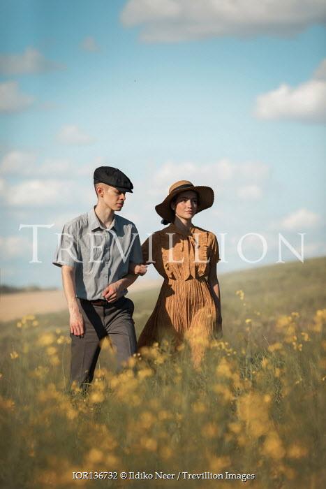 Ildiko Neer Vintage couple walking in meadow