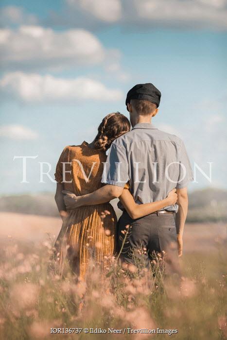 Ildiko Neer Vintage couple hugging in meadow