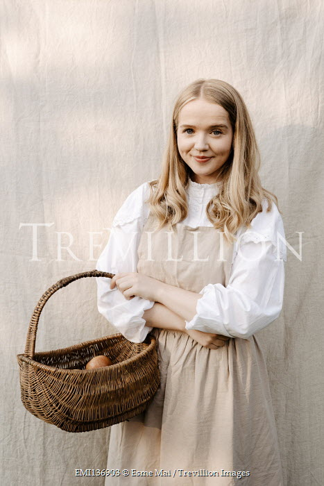 Esme Mai BLONDE WOMAN STANDING WITH BASKET OF APPLES