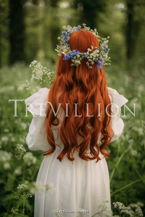 Rebecca Stice WOMAN WITH RED HAIR AND GARLAND STANDING IN COUNTRYSIDE