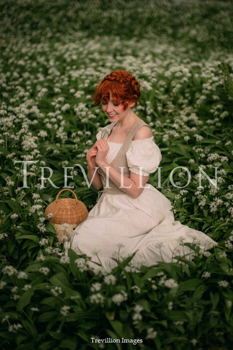 Rebecca Stice HAPPY WOMAN WITH RED HAIR SITTING BY WHITE FLOWERS