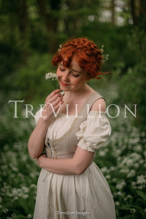 Rebecca Stice WOMAN WITH RED HAIR AND WHITE FLOWERS OUTDOORS