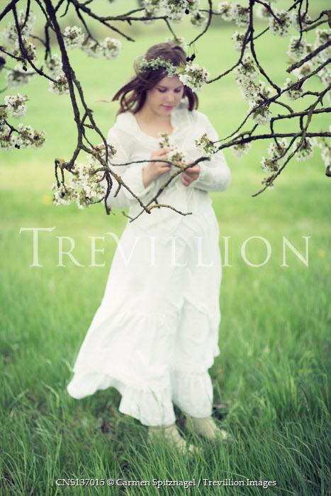 Carmen Spitznagel GIRL IN WHITE BY TREE IN BLOSSOM