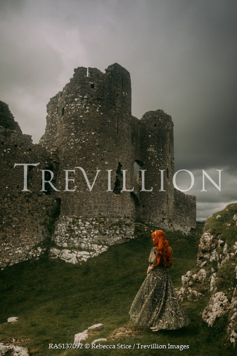 Rebecca Stice WOMAN WITH RED HAIR WATCHING RUINED CASTLE