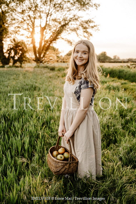Esme Mai BLONDE WOMAN WITH BASKET OF APPLES IN FIELD
