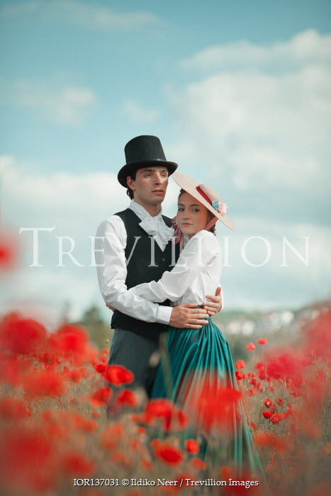 Ildiko Neer Historical couple embracing in poppy field