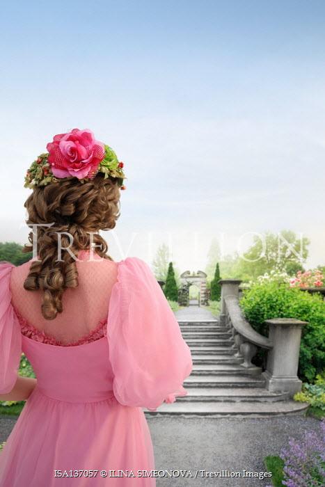 ILINA SIMEONOVA WOMAN IN PINK WATCHING GRAND GARDEN WITH STEPS