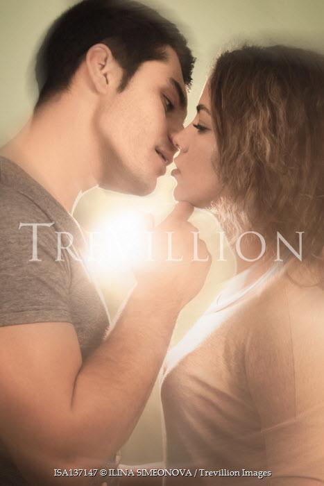 ILINA SIMEONOVA YOUNG COUPLE KISSING IN SUNLIGHT