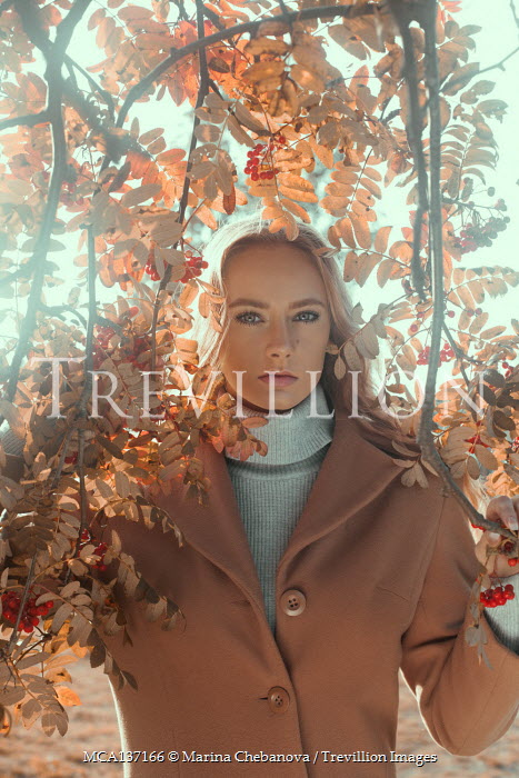 Marina Chebanova WOMAN IN COAT BY TREE WITH BERRIES