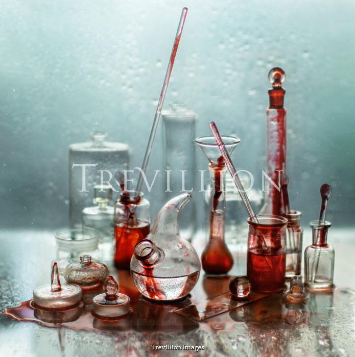 Andreeva Svoboda GLASS BOTTLES IN PUDDLE OF RED LIQUID